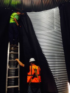 RainBank employees hang a 25 mil. PVC liner for an 18,000 gallon tank.