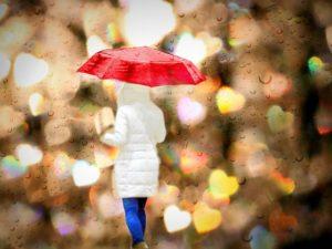 woman in rain-756647_640